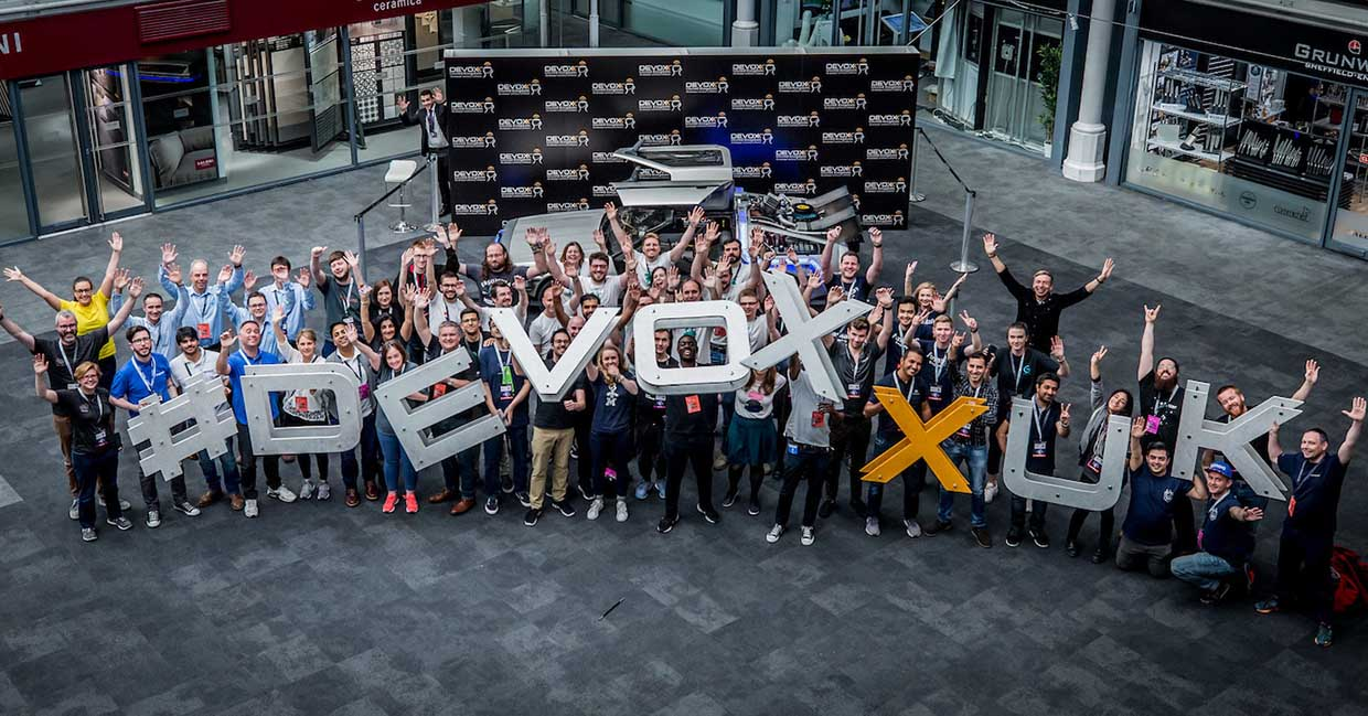 Volunteers holding letters spelling Devoxx UK